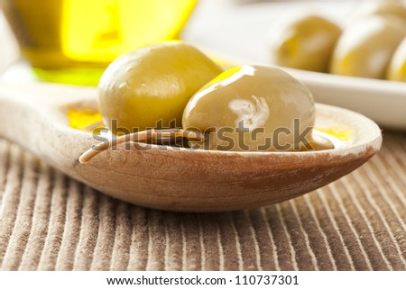 Fresh Organic Green Olives on a background
