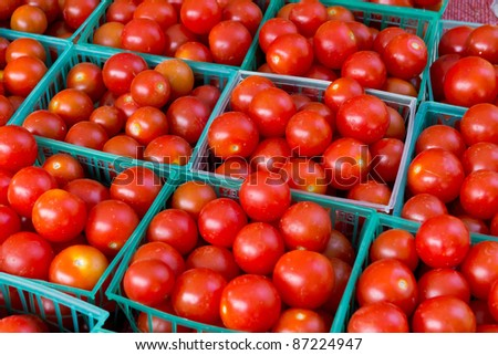 Fresh, organic,hand picked ripe tomatoes for sale at a roadside farm market