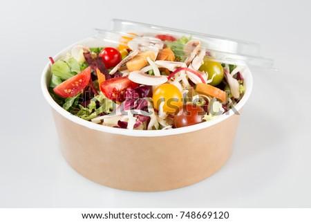 Fresh organic mixed green salad with pumpkin in carton kraft box  #748669120
