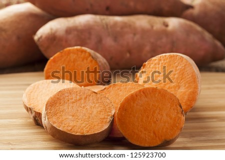 Fresh Organic Orange Sweet Potato against a background
