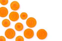 Fresh organic slice of orange carrot isolated on white background. Top view. Flat lay. Copyspace for text.