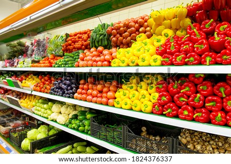 Fresh organic Vegetables and fruits on shelf in supermarket, farmers market. Healthy food market concept. Vitamins and minerals in vegetables and fruits. Fresh vegetables tomatoes, capsicum, cucumbers