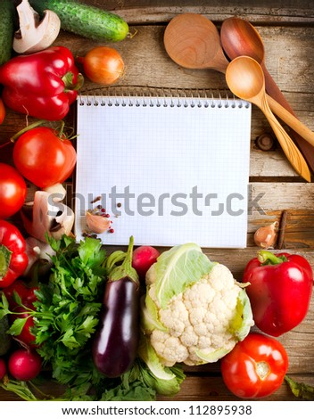 Fresh Organic Vegetables and Spices on a Wooden Background and Paper for Notes. Open Notebook and Fresh Vegetables Background.Diet.Dieting.Space For Your Text #112895938