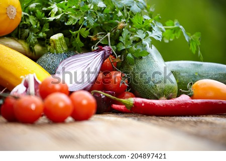 Fresh organic vegetables ane fruits on wood table  in the garden
