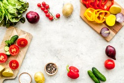 Fresh organic vegetables for healthy food cooking on light stone background top view mock up