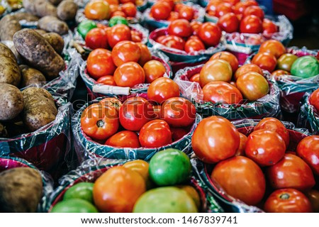 Fresh organic vegetables on sale in buckets at a local farmer's market #1467839741