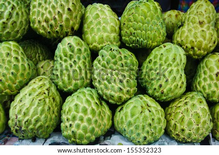 Fresh organic white bulb Custard Apple for sale at a market for farm products