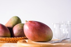 Fresh palmer mango fruit on wooden, Tropical fruit