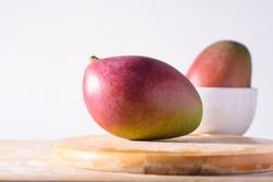 Fresh palmer mango fruit on wooden with white background, Tropical fruit