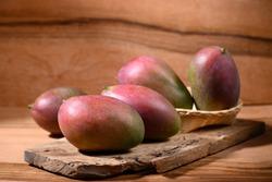 Fresh palmer mango on wooden background, Tropical fruit