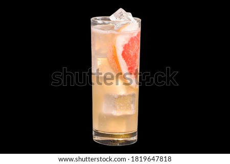 Fresh Paloma Cocktail with ice cubes in a glass, isolated on black background Foto stock ©