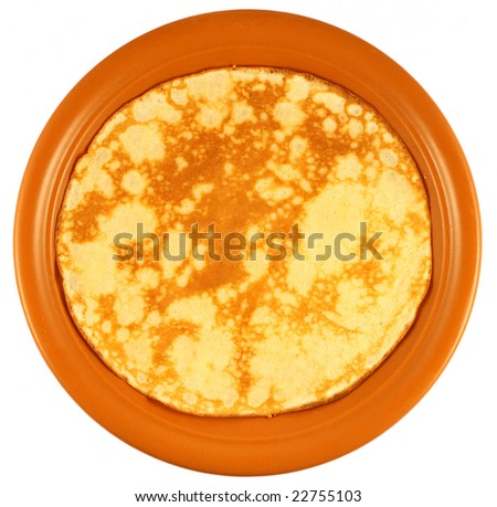 Fresh pancake on a plate isolated on white