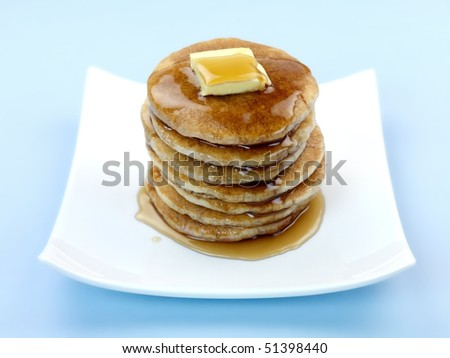 Fresh pancakes isolated against a blue background