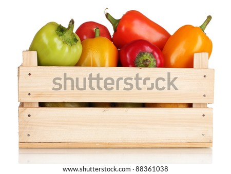 fresh paprica in wooden box isolated on white