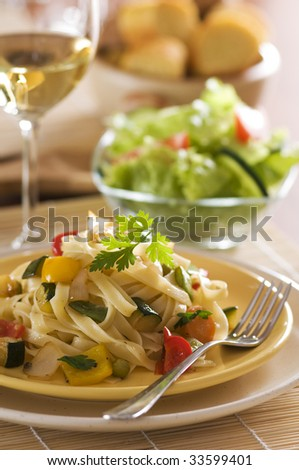 Fresh pasta salad with roasted vegetables close up