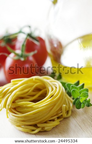 fresh pasta with tomatoes and olive oil in the background