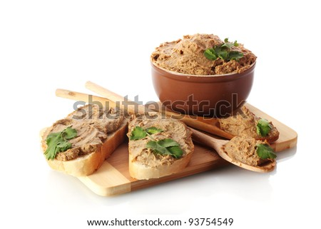 Fresh pate with bread on wooden board isolated on white