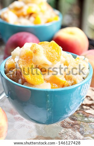 Fresh peach cobbler served outdoors.