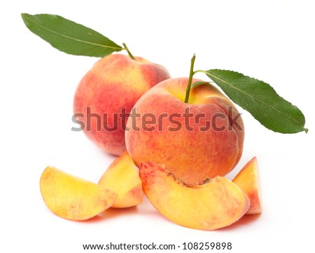 fresh peach fruits with cut and green leaves isolated on white background