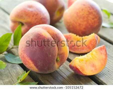 Fresh peaches on a board, selective focus