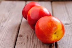 Fresh peaches on a wooden table fresh from the tree