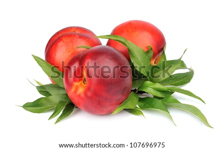 Fresh peaches with leafs on white