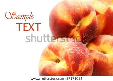 Fresh peaches with water droplets on white background with copy space.  Macro with shallow dof.