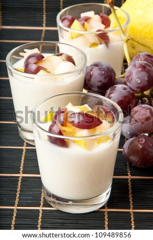 Fresh pear and grape yogurt in glass