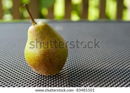 Fresh pear on garden table