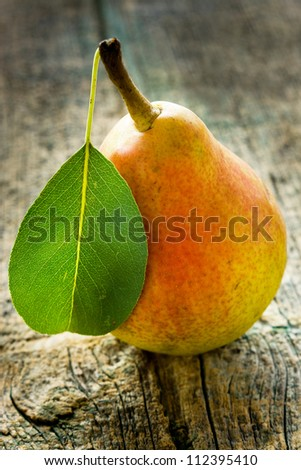 Fresh pear on old wooden table