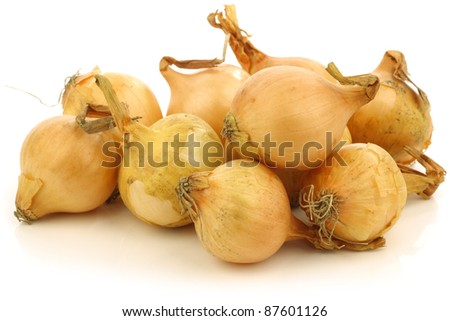 fresh pearl onions on a white background