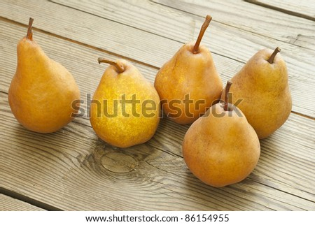 fresh pears on old wooden table