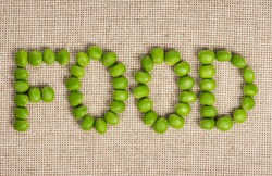 Fresh peas located in the form of a word on a sacking