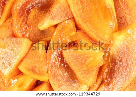 fresh peeled persimmon slices, can be used as background