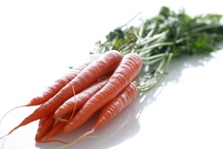 fresh picked carrots isolated on white