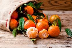 Fresh picked mandarins on wooden background