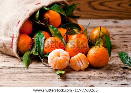 Fresh picked mandarins on wooden background #1199760265