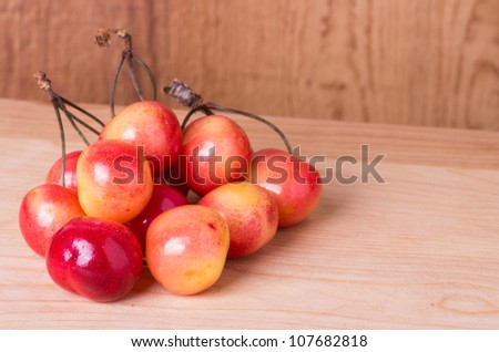 Fresh picked ripe cherries on wooden table
