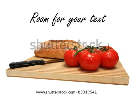 fresh picked vine ripened tomatoes and fresh baked french bread on a wooden cutting board with a knife, isolated on white with room for your text.