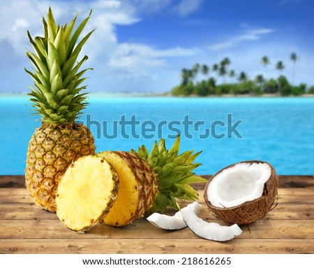 fresh pineapple and coconut in tropical landscape #218616265