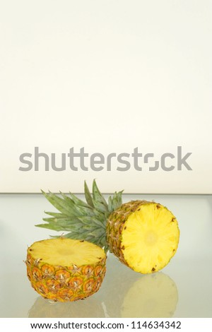 Fresh pineapple halves with room to use as copy space.