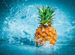 Fresh pineapple in water splashes