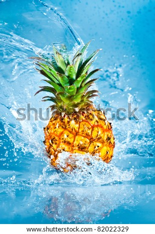 Fresh pineapple in water splashes