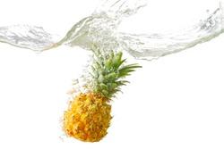 Fresh Pineapple splash in water