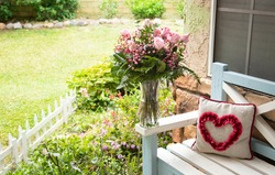 Fresh pink roses bouquet front of the garden. Valentine's flowers. Home gardening. Delivery flowers  the front door.