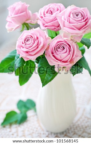 fresh pink roses on a table.