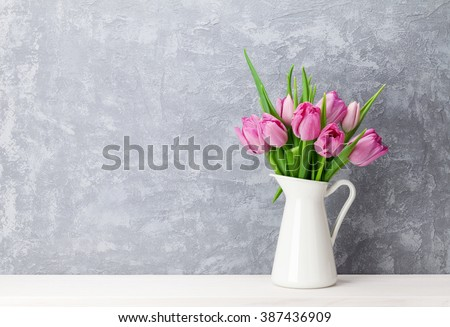 stock photo fresh pink tulip flowers bouquet on shelf in front of stone wall view with copy space 387436909 - Каталог — Фотообои «Цветы»
