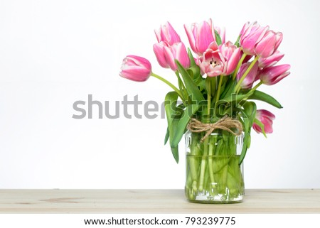 Fresh pink tulips on the table #793239775