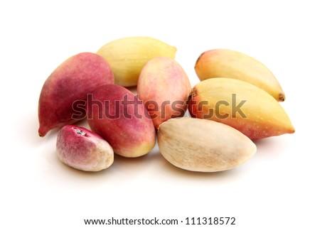 Fresh pistachios on a white background