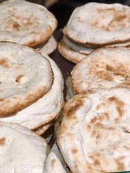 Fresh pita in bakery shop close up